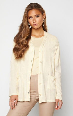 This is an Image of the Reese Cardigan in Cream. This Beautiful Cardigan is Soft to the Touch and has a Ribbed Effect.  It Has an Over-Shirt Silhouette with buttons up the front and is Easy to Style Over Jeans or Dresses for Chilly Summer Evenings.   It can be worn Closed or Open over a T-Shirt or Cami.  Also Available in Pink/Beige