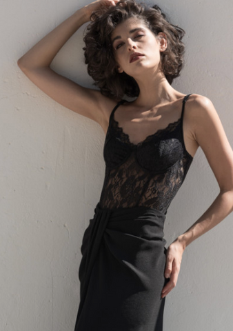 This is an image of the Rose Lace Bodysuit which is Black and has lace detail all over with thin bra straps.