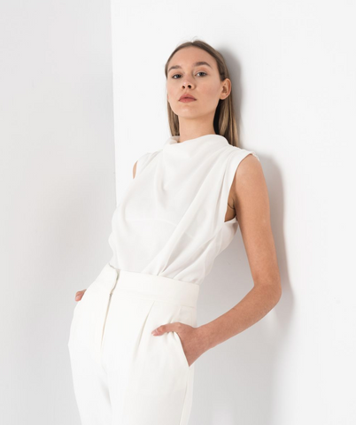 Add a touch of Elegance with our Danielle Pleated Sleeveless Blouse  With a gathered detail on the neck and a slight capped sleeve.   This Blouse has an invisible zip closure down the back of the neckline.  Ideal for tucking into Jeans, Suit Pants, or Skirts.  Available in White & Lime