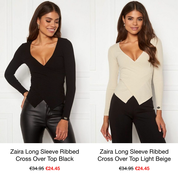 The Zaira Ribbed Long Sleeved Crossover top in Black & in Cream. This top has a Deep V Neckline and a Split detail at the bottom. The fabric has a Rib effect and is Soft, Comfortable and Stretchy.  A beautiful, essential piece that can be styled in various ways. Has an emblem detail on the left Cuff which adds a touch of Sparkle. If this top is too low cut for you why not add a lace Cami Top underneath.