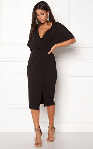 This Perfect Little Black Dress can be dressed up for Functions or worn for Work. This Dress is made of a Stretchy Fabric that Hugs the Figure nicely.  It has an Overlay Detail Enhancing the Waist and creating Shape. It has a V Neckline and a Slit on the Side.  This dress has a Side Zip Closure. It is Small Fitting so if you are between two sizes we recommend opting for the Larger Size.  Allows for loads of Accessorising, Add a Thin Belt to the Waist, Some Oversized earrings, and layered Necklaces to make this look your own.