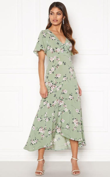 This is an image of the Therese Midi Dress. Tessa Tea Time Top with Wrap Detail Pistachio