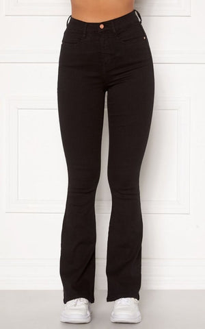 They have a Skinny Fit from the Waist Down to the Knee and are still Super Flattering on the thighs and Bum area.  They are Super Stretchy making them Comfortable to wear and are ideal for giving your legs a longer more slim look.  Since the jeans are super stretchy, they look smaller than they are. Select your regular size, but if you are between two sizes, please select the larger size.  Also Available in Light Blue Denim & Medium Blue Denim.