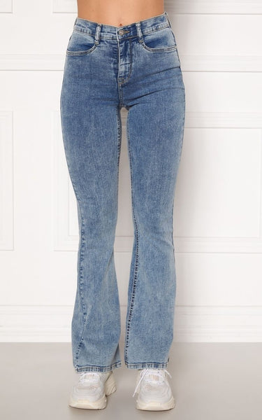 This is an Image of the Tove Jeans in Light Blue Denim. Introducing a new fit for Spring/Summer, The Tove Jeans are High Waisted and Flare at the bottom.  They have a Skinny Fit from the Waist Down to the Knee and are still Super Flattering on the thighs and Bum area.  They are Super Stretchy making them Comfortable to wear and are ideal for giving your legs a longer more slim look.  Since the jeans are super stretchy, they look smaller than they are. Select your regular size, but if you are between two sizes, please select the larger size.