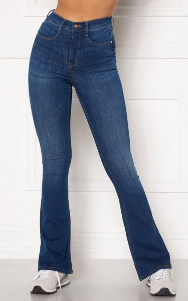 Introducing a new fit for Spring/Summer, The Tove Jeans are High Waisted and Flare at the bottom.  They have a Skinny Fit from the Waist Down to the Knee and are still Super Flattering on the thighs and Bum area.  They are Super Stretchy making them Comfortable to wear and are ideal for giving your legs a longer more slim look.  Since the jeans are super stretchy, they look smaller than they are. Select your regular size, but if you are between two sizes, please select the larger size.