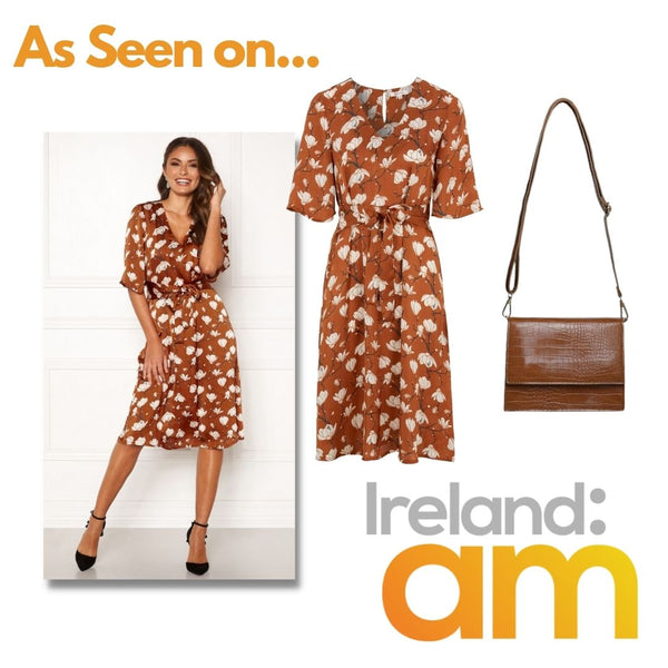 This is an image of the miriam vintage style midi dress in Rust with white floral print and the indie handbag in brown