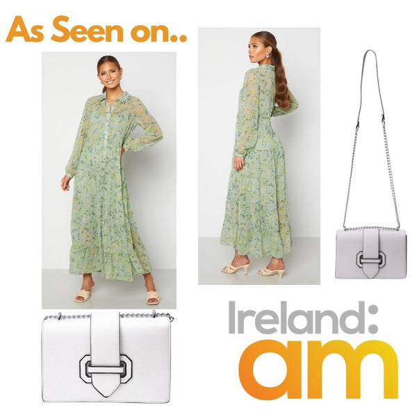 This is An image of the Elsie Green floral print maxi dress and the poppy chain Strap Handbag in Silver as seen on Ireland AM