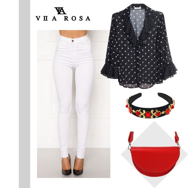 This is a picture of our beverly white high waist skinny jeans styled with our blake polka dot blouse, our red gem embellished hairband and our olive handbag in red