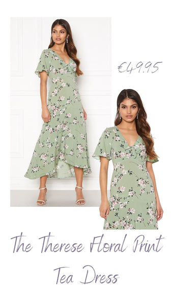 This Short Sleeved Dress has a Stunning Floral Pattern throughout and is Feminine and Elegant.  It has a Decorative Tie detail in the middle at the Front of the Bust, a Fancy Cut Under-bust and a Relaxed Silhouette.  It has a High Low Hem and is Tea Length, And Looks Stunning With Heels for a Special Occasion.