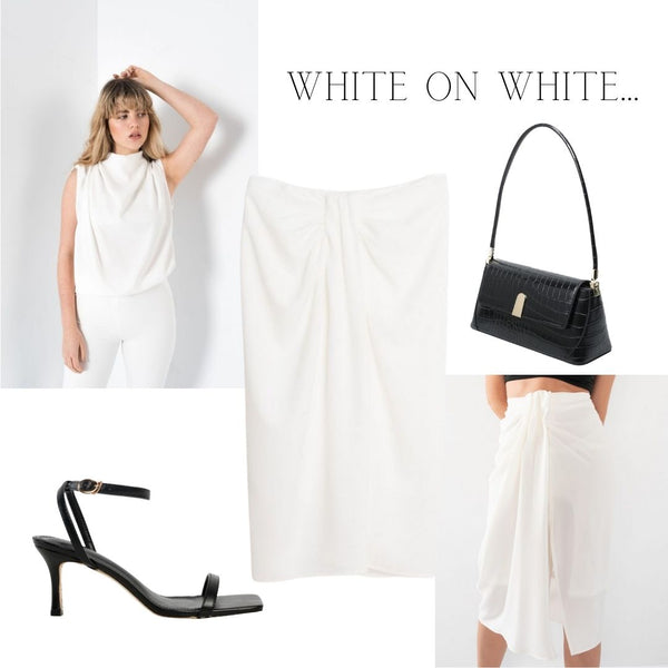This is a Summer Outfit Idea for Occasion Wear. The Danielle Gathered Blouse in White styled with the Camila Knotted Midi Skirt in White with the Gabriella single strap black handbag to break it up.