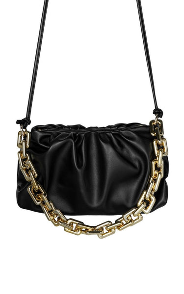 The Bag of the Season Has arrived!  The Donna Shoulder bag has a Chain strap detail, a bunched up effect and a luxurious feel.  It has a thin, Extra long strap which can be knotted at various length depending on your Outfit.