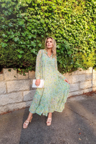 This is an image of stylist and presenter Rosalind Lipsett wearing our Elsie Green Tiered Maxi Dress with our Poppy Silver Chain Strap Handbag
