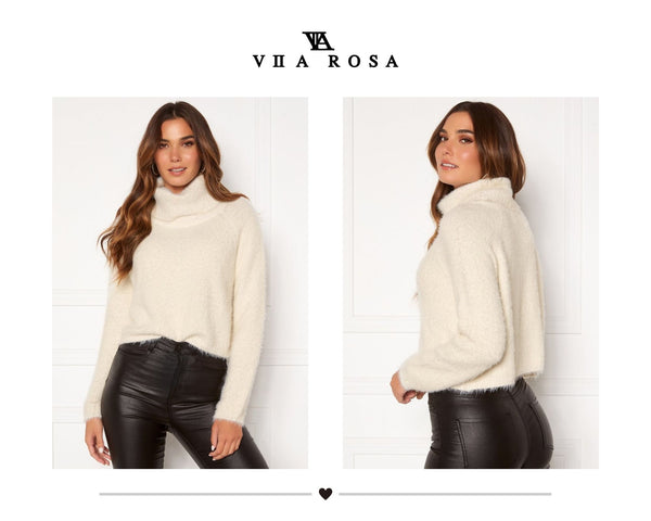 This image shows the arianna jumper which is a cropped polo neck that has a furry texture all over. It is cream in colour.