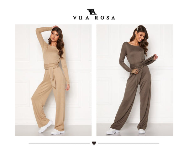 This is an image of our Maya knitted jumpsuit which is long sleeved, it has a V shape at the back and can be worn reversed and has a thick knitted waist belt attached that can be wrapped in different ways. This pic shows the Maya jumpsuit in both light beige and light brown