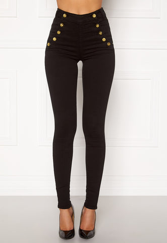 This is an image of the Rochelle High Waist Jeans, they have gold button closures on both sides of the waist and are skinny fit. They are black.