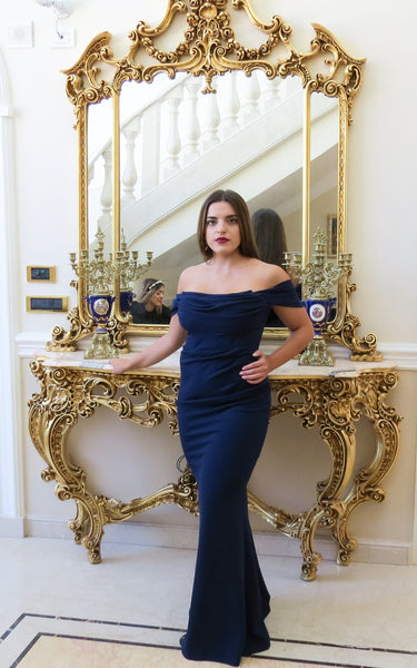 The Bella dress has an off the shoulder style with a draped cowl neckline.  It is Maxi length making it ideal for Bridesmaids, Black Tie and Debs.   It has boning on the bodice which makes it supportive and structured and a gather detail at the side is super flattering. It has an invisible zip at centre back. A beautiful dress on all body types.