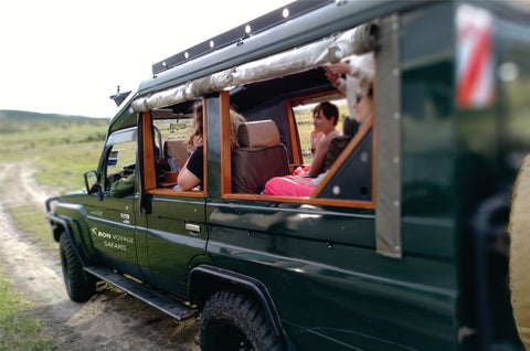 A small group of 4 people inside a private 4x4 jeep enjoying full attention from a personal driver-guide to Masai Mara.
