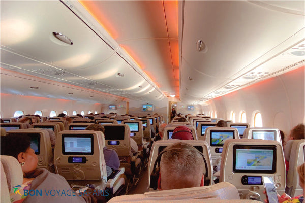 People sitting on airplane seats flying to Masai Mara National Reserve during 3-day fly-in safari Kenya budget tours