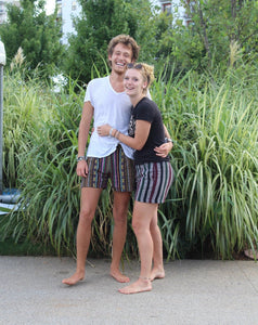 Male & female both wearing Medium Regular shorts