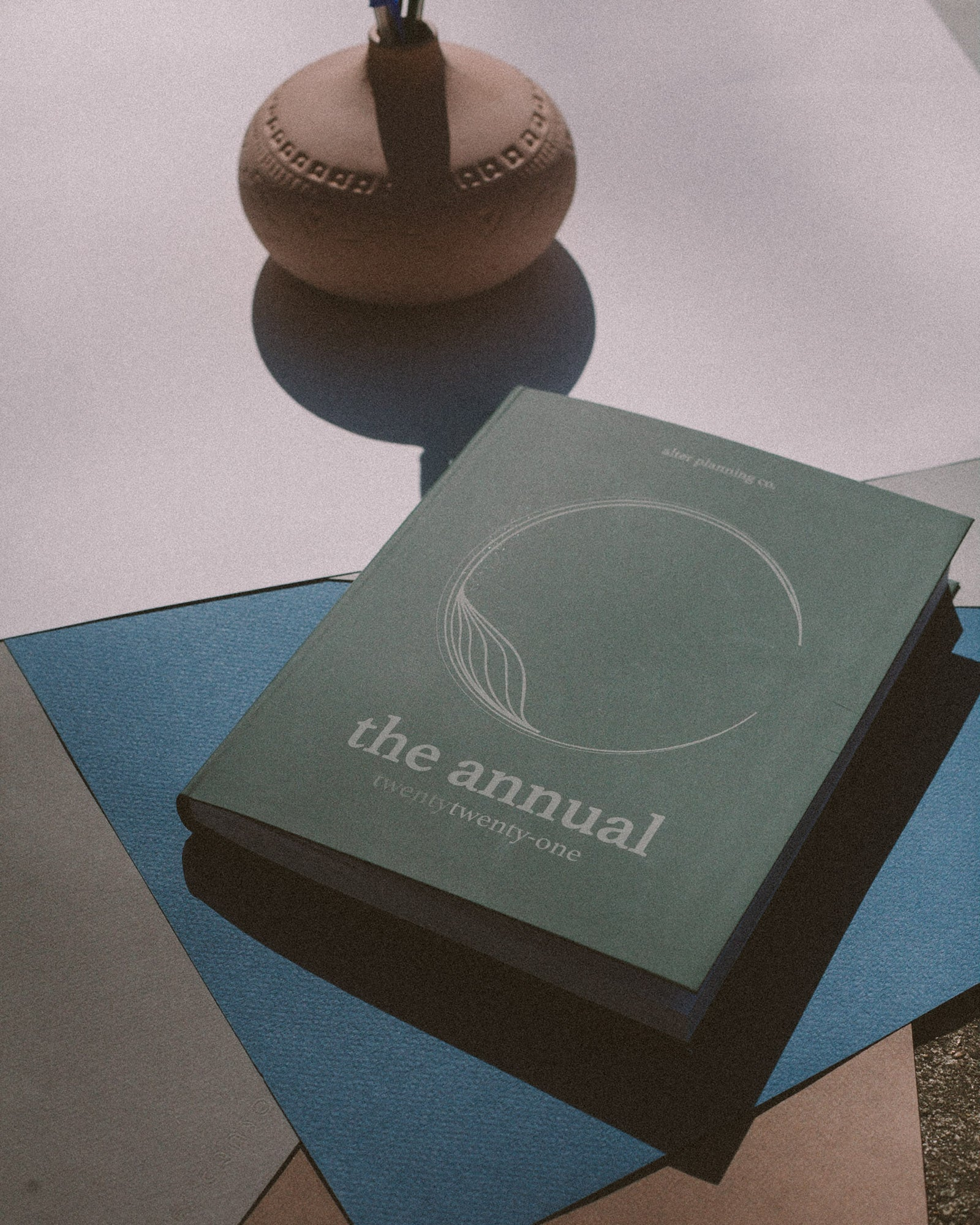 "image of alter planning co. product ""The Annual"" in green, on a blue and white background."