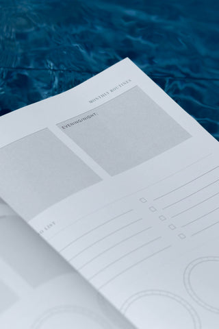 picture of alter planning co 2022 annual planner in a pool of water