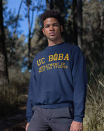Man wearing a UC Boba Sweater in front of a Forest - Boba Shirt