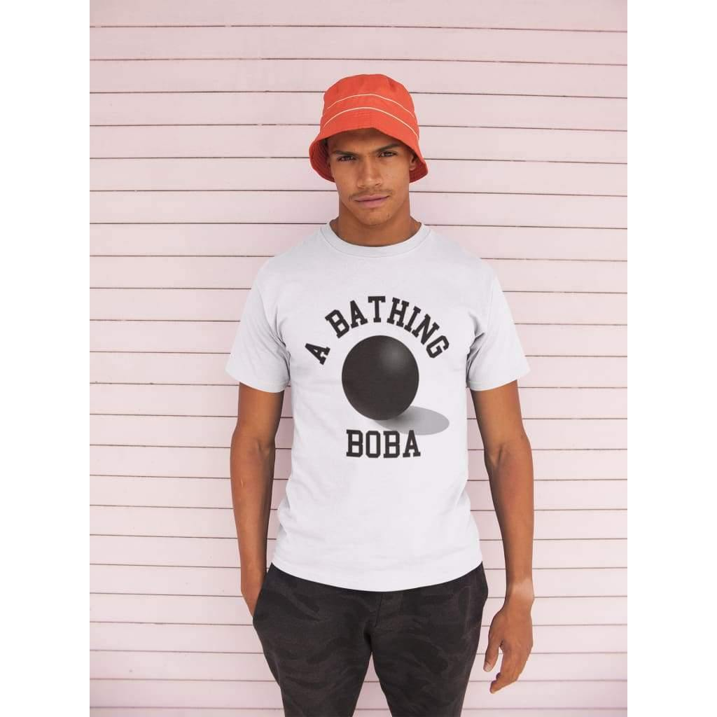Man wearing a Bathing Boba Shirt with an orange hat
