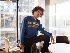 Man wearing a UC Boba Sweater In Front of An Office
