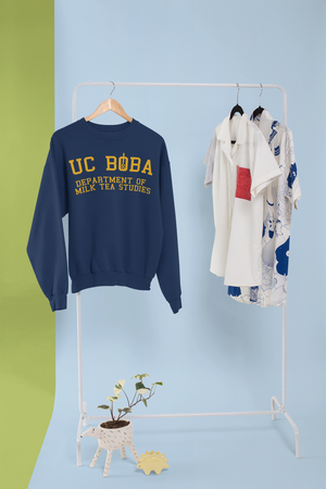 A UC Boba Sweater Being Hung on a Rack
