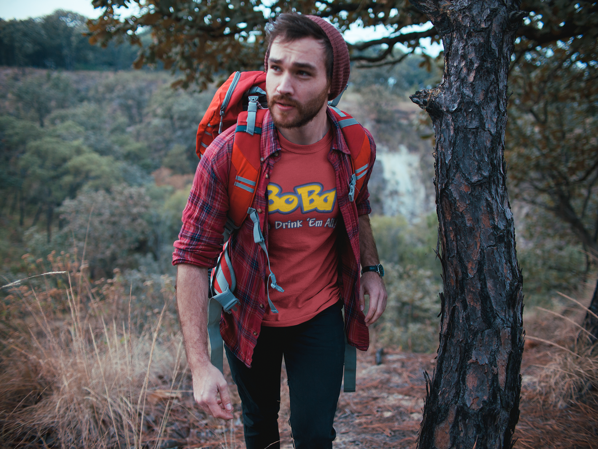 Hiking man wearing a red milk tea shirt