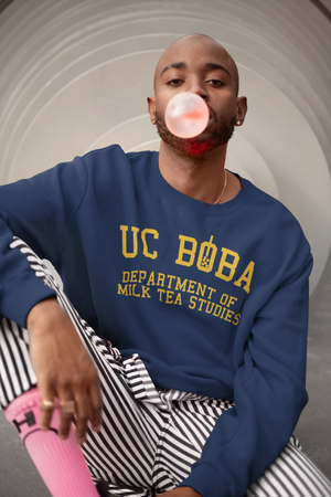 A Trendy Man Wearing a UC Boba Sweatshirt Blowing Bubble gum