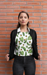 Woman wearing Boba Leaves Shirt against a Brick Wall