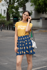 Woman wearing an Orange Shirt while posing with the Boba Skirt