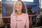 Smiling woman wearing a Boba Bae sweater