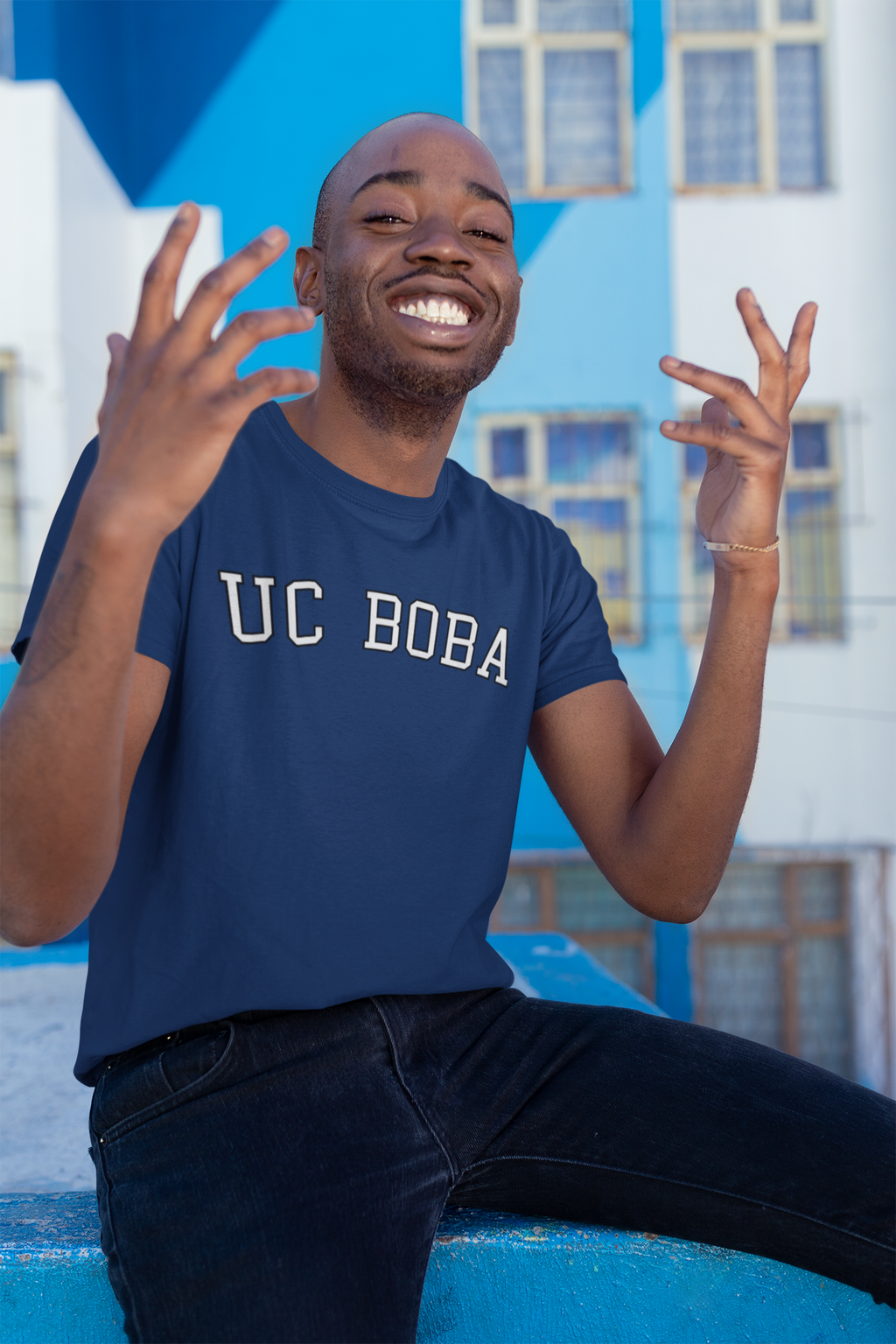 Happy man wearing UC Boba School Shirt