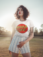 Woman wearing a Boba Life T-Shirt against the sunset