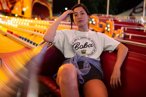 Woman in a carnival seat wearing sponsored by ABG Shirt