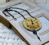 Antique clock face steampunk necklace, A Worn Face