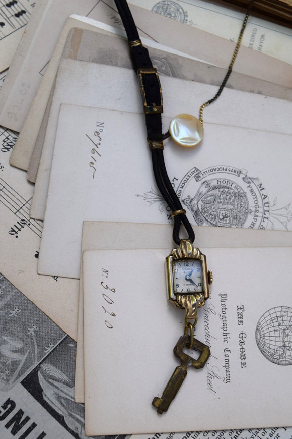 Antique watch and button necklace, Button Time