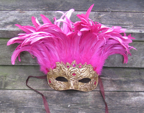 Pink and gold feathered Venetian style mask.