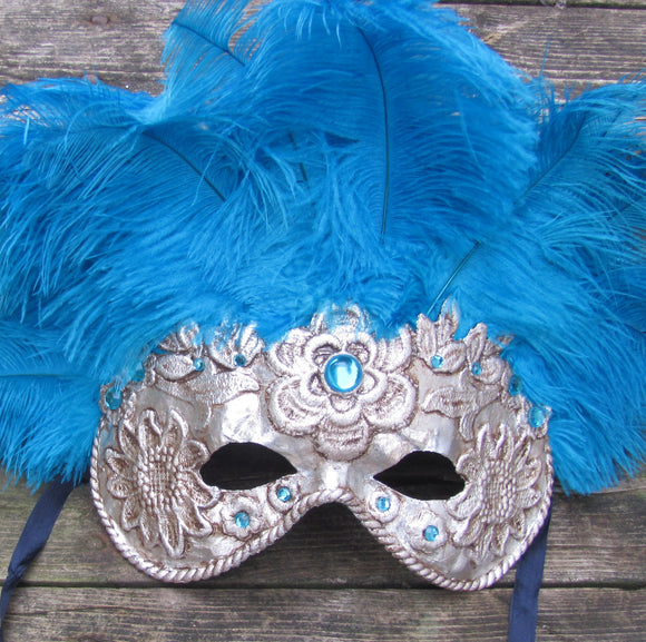 Blue feathered silver Venetian mask.