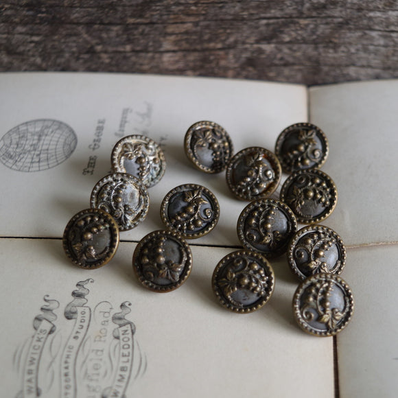 Set of antique Victorian brass cut-out buttons with grape motif