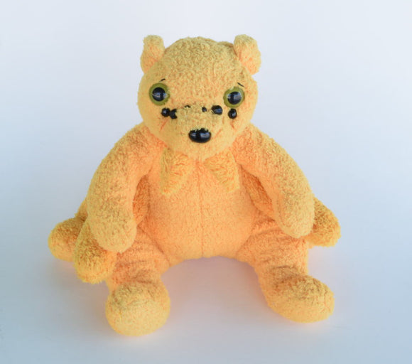 Large yellow plush spiderbear, creepy bear monster