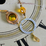 Gold vintage watch case and band necklace, Golden Eye