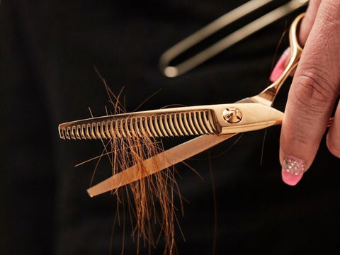 Rose Gold Thinner hold in hand black with red hair on blade
