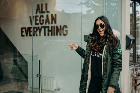 Hoodlamb Vegan Hemp Parka worn by model in front of Imperative All Vegan Everything Sign in gold