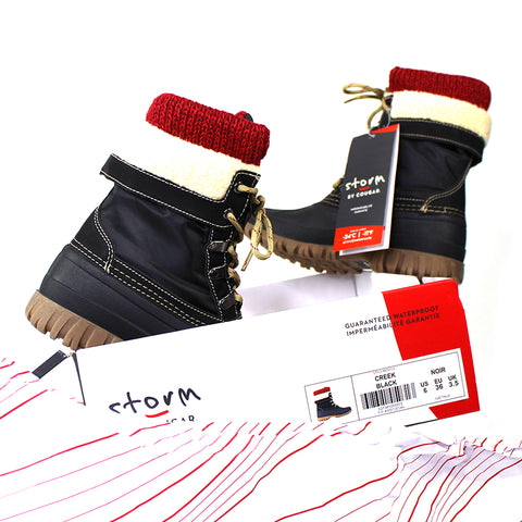 Cougar Storm Creek Winter Boots on top of their box in Black with red sock details