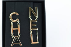 Golden CHANEL Drop Earrings