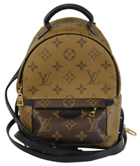 727123125911 Reverse Monogram Palm Springs Mini Backpack