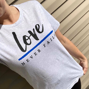 Love Never Fails Unisex Top (TBL)
